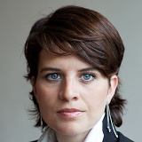 Ms Emilie Perrot speaking at Rail Experience Europe 2014